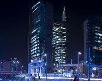 Milan Porta Nuova square night lights. Night scene from one of the new and most popular district in Milan named Porta Nuova. Long exposure tecnique stock photography