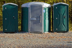 Porta Potties. Some portable toilets located on the wooded hiking trail royalty free stock photos