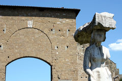 Porta Romana e statua a Firenze. Door to enter inside historic centre of Florence and famous statue outside Stock Photo