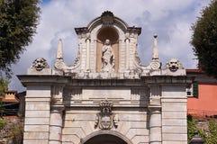 Porta Romana - Sarzana Liguria Italy. Porta Romana (Roman gate) the eastern gateway to the city of Sarzana with the emblem of the city of Genova, La Spezia Stock Photo