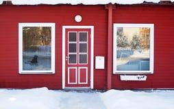 Porta rossa nell'orario invernale Fotografia Stock