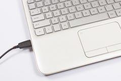 Porta USB di un computer portatile Immagini Stock