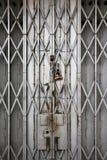 Porta velha da porta de dobradura do metal Imagens de Stock Royalty Free