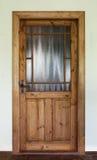 Porta velha de madeira de Brown com vidro Fotos de Stock Royalty Free