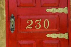 Porta vermelha número 230 Imagens de Stock