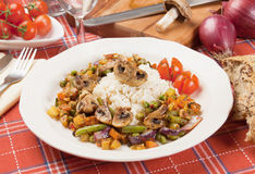 Portabello mushrooms with rice and vegetables Stock Image