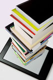 Portability of books. Within a tablet or e-reader Royalty Free Stock Photography