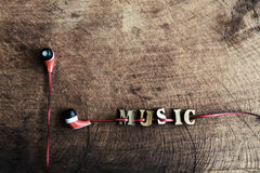Portable audio earphones on old wood textured Stock Photo