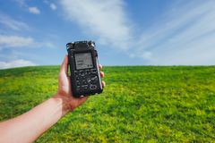 Portable audio recorder in hand field recording ambient sounds Stock Photos
