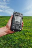 Portable audio recorder in hand field recording ambient sounds Stock Images