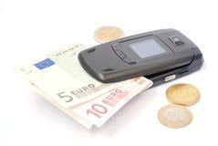 Portable avec des pièces de monnaie Images stock