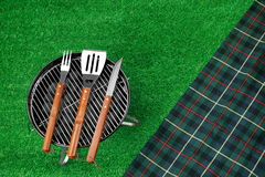 Portable Barbecue Grill On The Lawn, Grill Tools And Blanket Stock Photography