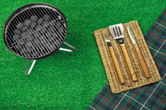 Portable Barbecue Grill On The Lawn, Grill Tools And Blanket Stock Photo