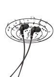 Portable black earphones to listen to music Stock Image