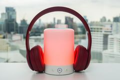 Free Portable Bluetooth Speaker In Red Color With Cute Pink Wireless Headphones For Pairing To Listen To Music Stock Image - 123964811