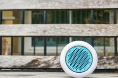 Portable Bluetooth wireless speaker on wooden bench. For music Royalty Free Stock Photos