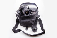 Portable camera bag. With dslr camera and lens on white Royalty Free Stock Images