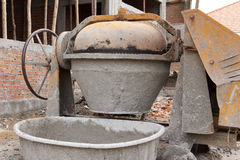 Portable cement mixer. Old weathered portable cement mixer Stock Image