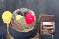 Cement mixer on rain is waiting a sunny day. Royalty Free Stock Image
