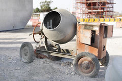 Portable concrete mixer. Mixes cement with sand, gravel and water Royalty Free Stock Images