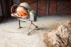 Portable concrete mixer and sand Stock Photography
