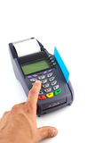 Portable Credit Card Terminal on Base. Hand with credit card swipe through terminal for sale Royalty Free Stock Images