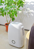 Portable dehumidifier colect water from air stock images