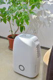 Portable dehumidifier colect water from air stock photos