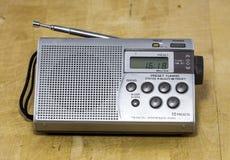 Portable Digital Radio. Portable AM/FM digital radio with antenna on wooden background Stock Image