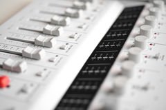 Portable digital sound mixer. (Buttons And Knobs Closeup-short focus Stock Images