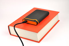Portable Disk on Book Royalty Free Stock Photography