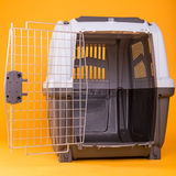 Portable dog cage. On yellow Stock Photo