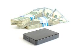 Portable drive USB on dollars pile for data is money concept Royalty Free Stock Photo