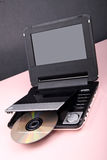 Portable DVD player. Isolated on pink and black Royalty Free Stock Images