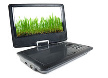 Portable dvd player and tv. Isolated on white background with to the images of grass on a monitor Stock Photos