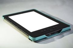 The portable e-book with the clean and white screen. stock photo