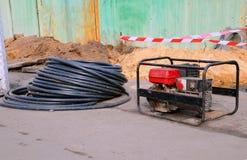 Portable electric generator. Repair of road work. Stock Photography