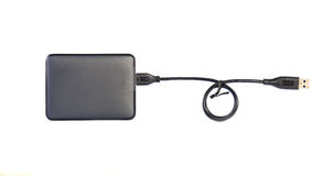 Portable external HDD hard disk drive with USB cable on white ba. Ckground Royalty Free Stock Photos