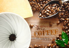 Portable filter with coffee beans Royalty Free Stock Image