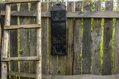 Portable folding solar panel battery hanging on a wooden fence n Royalty Free Stock Images