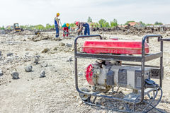 Portable fuel generator for electric power supplies at construct stock photography