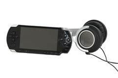 Portable game station with large headphones Royalty Free Stock Photos