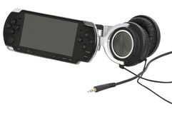 Portable game station with large headphones. Gadgets, gizmos fun and gaming stuff on white background stock photography
