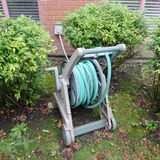 Portable Garden Hose Reel. Portable hosepipe on wheeled trolley for garden watering stock photo