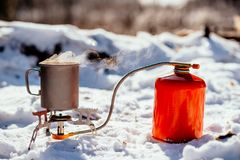 Portable gas burner in a winter forest. Bushcraft, hunting and p. Eople concept stock image