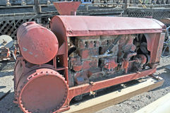 Portable Gas Powered Generator. This device is an antique portable gas powered generator meant to be moved from site to site as needed. Note the heavy metal Royalty Free Stock Image