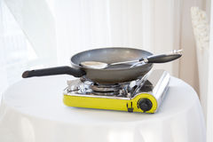 Portable gas stove on the table. In restaurant Royalty Free Stock Images