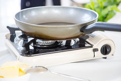 Portable gas stove on the table. In restaurant Royalty Free Stock Image