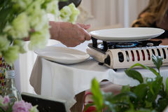 Portable gas stove on the table. In restaurant Stock Photo