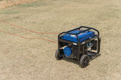 Portable gasoline power generator and wires outdoor stock photos